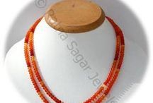 Carnelian Gemstone Beads / Carnelian Gemstone - is an energetic gemstone & enhances courage, boldness, self confidence and determination of the user. It also strengthens their ability of taking decisions strongly. These gemstones are available online at Ratna Sagar Jewels.