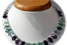 Fluorite Gemstone Beads / Fluorite Gemstone - It helps one to live in the moment without a sense of spiritual emptiness. It also guards against psychic attack. These gemstones are available online at Ratna Sagar Jewels.