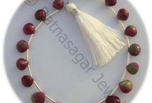 Ruby Zoisite Gemstone Beads / Ruby Zoisite Gemstone - generates an aura of positive energy around the user and is helpful in enhancing the physical ability of the user. It is also helpful in strengthening the immune system of the user and also enhances his creativity. These Gemstone Beads are available online at Ratna Sagar Jewels.