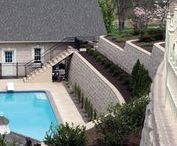 Pool Landscaping Ideas / Whether you're planning the perfect new pool area or looking to upgrade your current pool patio area, you'll find relaxation inspiration in our swimming pool landscaping design ideas. Add an Anchor™ wall to your poolside, waterfront or water element and you're sure to make a splash. Visit www.anchorwall.com to find the Anchor Wall retailer nearest you.
