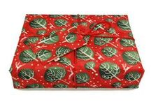 """Crackle Wrap - Beautiful fabric gift wrap / A luxurious ethical alternative to wrapping paper, this flat, reusable fabric Crackle wrap folds neatly around box shaped gifts without the need for scissors or tape.  Using its ingenious integrated wrapping cord and button, you can create a fabulous looking gift in seconds.  And because our gift wrap is made from fabric, you don't have to throw it away.  The Crackle is made from a double-layered fabric with a crinkly inner leaf that gives a delightful """"crackle"""" sound as the gift is unwrapped."""