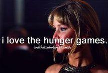 The Girl On Fire / The Hunger Games, Catching Fire, Mockingjay; Katniss Everdeen (Jennifer Lawrence) Peeta Mellark (Josh Hutcherson) Gale Hawthorne (Liam Hemsworth)