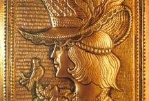 Munkáim---    My works / Vörösréz lemezből készült domborművek   -copper embossings Fafaragások                                            -wood carvings Akvarellek Olajfestmények Grafikák