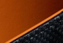 Carbon Fibre Vibrant / One of the hallmarks of this season's launch has been the striking combination of vibrant orange with richly textured carbon fibre leather.