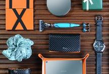 Christmas Gift Guide / We're featuring a selection of design-led, contemporary gifts for men, with a focus on carbon-fibre and blazing orange leathers, mirror-polished and engraveable stainless steel, deep blues, and turquoise accents.