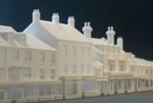 3D Printing buildings in British N Scale / Images of my 3d printed buildings in British N Scale (N Gauge - 1:148th) for railway modelling layouts. I use to print my models in WSF material from Shapeways (nylon) and quality of models is quite good with well defined tiny details as bricks, tiles, gutters, windows, doors, chimneys, shopfronts, etc.  Why don't you take a look in my 3d printing shop?  https://www.shapeways.com/shops/ngauge_es