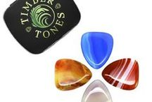 AGATE TONES / Agate Tones are precision manufactured from the very best quality Agate. Dimensions are approx 30mm by 26mm and are 4.5mm thick tapering down to 1mm at the playing tip. Due to the hardness level of the material we have designed these to have a large playing tip area to overcome their brittleness and as a welcome side affect they have a very nice warm tone. We recommend these plectrums for precise picking on Arch Top Jazz Guitars.