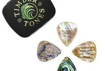 ABALONE TONES / Abalone Tones are precision manufactured guitar picks from the very best quality Abalone Shell. We source off cuts of Abalone from the Guitar & Furniture Inlay Industries and manufacture them into beautiful 3D Jazz III shaped Guitar Picks. They are 1.4mm thick with a rounded taper down to 0.8mm at the playing tip. They measure 25.6mm long by 23.6mm wide.
