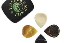 GROOVE TONES / Groove Tones are one of our largest most chunky Guitar Plectrums. They are aimed at people who require some extra help with Grip as they have a large surface area, a scoop for the thumb on the top and a groove for the first finger on the bottom. They are hard wearing with a sharp playing tip.