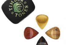 GROOVY TONES / Groovy Tones are designed to be some of the most comfortable Guitar Picks in the world. They are for players who want the speed and accuracy usually associated with a Jazz III Style Guitar Pick, however they have a larger grip area which includes a scoop for the thumb and a right hand orientated Groove for the first finger. They are hand sculpted to be smooth and extremely tactile.