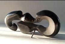 Velocity / Velocity is a sculpture by Jeremy Guy, carved from black granite