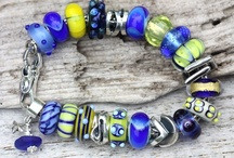 Unique Trollbeads / Trollbeads is the only bead company that specializes in Unique beads.  Each bead is made by artists who only make unique beads and with each bead the design/color/size is unique.  While they can be similar they are not part of the line beads we see in the Trollbeads catalogs. Here is a link to Trollbeads Gallery Uniques:http://www.trollbeadsgallery.com/categories/All-Unique-Beads/Glass-Unique-Beads/