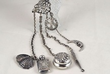 Chatelaine  / A chatelaine is a decorative belt hook or clasp worn at the waist with a series of chains suspended from it. Each chain is mounted with a useful household appendage such as scissors, thimble, watch, key, vinaigrette, household seal, etc.[1]  / by Tea Cottage Pretties - Beverly