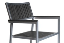 Malibu / Our stacking chair is made of a tough aluminum alloy 12 gauge frame and the seat and back slats are in PVC TEAK that looks like TEAK wood . Perfect for outdoor use such as patio of a restaurant or pool area or public spaces .