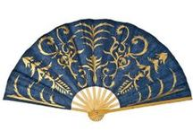 """Hand Fans - Mulberry Paper / These fans are made from sustainable Saa Paper which is made from the bark of the mulberry tree in Thailand. It is a more durable grade of paper than rice paper. Hand painted gold design. Bamboo frame. 10"""" long when closed."""