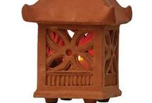 Lanterns - Garden & Patio / Made from terracotta clay. 8 inches wide x 8 inches high not including roof. Recommended for use with regular or battery-operated candles.