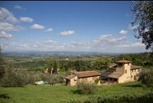 The outdoor of il Castagnolino / The rural building, lovingly restored, surrounded by olive trees, offers a unique view over the Towers of San Gimignano and the Valdelsa valley, Tuscany.