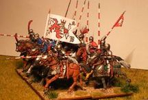 Middle Ages Warfare / Weapons, armour, equipment and heraldry.