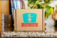 Aloha Crate: The Original Hawaii Subscription Box / Aloha Crate is the best Hawaii subscription box. Each crate contains a different surprise every month with a mix of arare, Kona Coffee, li hing mui mango, macadamia nut chocolate, tropical granola, lilikoi butter, guava jam, Maui Onion Mustard, taro chips, and much, much more! Your island adventure starts here!