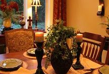 A Fairview Dining Room--Tuscan / PAINT # 2 Green & Blue -Tuscan-Use my tan/rose throw rug- HANG GOLD FRAMED RED/FLOWER PICTURE WITH RED BUFFET LAMPS / by Cheri Fox Smith