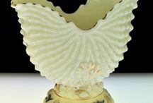 Custard Glass / First produced in England c1880, probably in Bristol, custard glass was mostly used to make salt cellars. There is some confusion over who first produced it in America but most sources attribute to Mr Northwood in 1887. Ditheridge started producing in 1894.  Please pin as many as you would like:)
