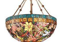 Tiffany les belles lampes de Louis Comfort Tiffany. / Louis Comfort Tiffany (né le 18 février 1848 à New York – mort le 17 janvier 1933 dans la même ville) est un artiste américain célèbre pour ses œuvres en verre teinté dans le style Art nouveau. Créateur de plusieurs entreprises, il a également peint, conçu des bijoux et des meubles.Sa première réalisation est une peinture réalisée alors qu'il est élève de George Inness en 1867. À 24 ans, il s'intéresse au travail du verre. Quelques imitations chinoises circulent.... !!!  . / by Mélanie
