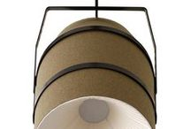 BIDONE / A suspension characterized by a contrast between form and material: the first geometric and rigorous, making reference to the industrial containers, but realized in a textile material that softens the object. The decision to use a refined and elegant material on the outside, as the precious fabrics, combined with the internal shield made of plissè, give the object a note at the same time elegant and rigorous.