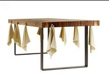 """HOOK / The natural charm of the wood and the burnished iron structural elements placed at the ends give to """"Hook"""" character and functionality. The hooks spreader along the side are intended to hang napkins and they accurately mark the seats giving a special style to the whole, acting as an unexpected element."""