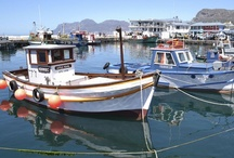 Kalk Bay, Cape Town / The unpretentious bohemian fishing village of Kalk Bay lies between the mountains and the sea, just 25 minutes' from Cape Town. Home to one of the last remaining working harbours in South Africa ... more info at http://www.sa-venues.com/attractionswc/kalk-bay.php
