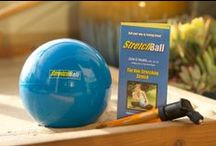 StretchBall   By Julie E / Roll your way to feeling great! StretchBall releases tight hips, chest, back, IT band, hamstrings, chest, shoulder and more…in literally seconds. Roll for 5 minutes or an hour. StretchBall folds quick, travels easy and small – so you can feel great wherever you go!