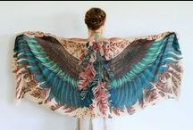 Beautiful Scarves ~ Wings / Birds are a popular motif in women's fashion, and Roza Khamitova, a Melbourne-based fashion designer originally from Kazakhstan, has created a series of scarves that definitely exploit the bird motif in a creative way. Each scarf, when worn as a shawl, creates the illusion that the person wearing it has enormous beautiful bird wings.