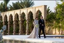 Elegant Palace Wedding (Mariana & Raul) / Brazilian couple Mariana and Raul were joined by 400 guests for a 3-day celebration in Marrakech. After a festive Moroccan themed sunset party, the couple celebrated their wedding at the stunning Palais Namaskar, with the bride arriving on a custom built walkway, wearing Elie Saab. The guests arrived for the ceremony under a tunnel of 25000 pale pink Atlas roses. Thousands of ivory flowers and candles were installed throughout the venue.