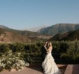 Romantic Atlas Wedding (Anna and Dom) / Australian couple Anna and Dom, fell in love with Kasbah Bab Ourika on an adventure trip to Morocco and knew instantly it would be the venue for their wedding. A year later 130 of their family and friends made the round the world trip to Marrakech for their summer celebration.  Tables were laden with olive branch, oranges and ivory local roses. Strings of fairy lights illuminated the outdoor dining area and lanterns led the way to the afterparty 'club' for late night dancing under the stars.