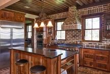 Custom Home / Truly a one of a kind retreat created in the South Carolina low country. Such an air of  casual elegance can be found in this hunting lodge with reclaimed wood walls, ceiling, stairs and floors. Brick accents compliment this stunning home made for entertaining  friends and family alike.