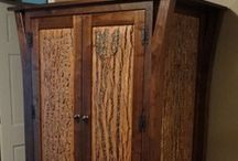 Traverse Bay Solid Black Walnut Furniture Collection / Beautiful black walnut is combined with natural bark, antique glass or copper panels to create a distinct and elegant sophisticated rustic piece of furniture. The furniture is hand-crafted with solid wood - no veneers. We use the finest ball bearing drawer glides with solid wood drawer boxes. This is a quality line of furniture that you will be handing down to future generations. Many new designs coming for this collection. If you like this style of furniture, we can craft whatever you need.