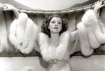 1930s / Hollywood set the tone and provided the perfect escape with toe tapping musicals, long sleek evening gowns & well dressed men in suits & tux...
