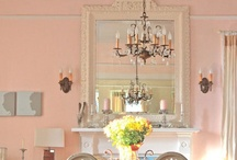 Home Decor: Pink Dining Room Ideas / Sparkly crystal chandelier, pink walls off-set with white trim, white corner built-in china cabinets, white French doors, long flowing white sheers, and at least one wall showcasing my large collection of gold-framed mirrors ... romantic, luscious, and complexion flattering ... So thankful for a husband who's not afraid of pink!