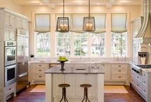 Home Decor: White Kitchen / Windows across the external wall instead of upper cabinets will flood kitchen with sunlight and provide a view of our beautiful wooded back yard. White cabinetry, black counters, and hardwood floor.