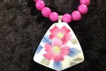 """Kikuko / Smooth semi-precious stone beads are hand-knotted by the Nozomi women to create this elegant necklace.  One-of-a-kind pottery shard. Silver toggle clasp. Most necklaces are 18""""L."""