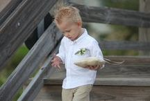 Little Boy Outfits / Boys will be boys so a simple short sleeve white button down shirt with khaki shorts or pants is best.  Little boys will come out of clothes faster than little girls so plan for the heat.
