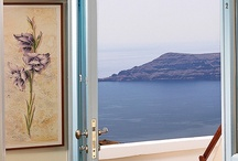 Accommodation / THOLOS RESORT consists of a complex of traditional studios, apartments and a new unit with suites. It is located in Imerovigli on the rim of the Santorini Caldera. It has a panoramic view of the famous Santorini sunset, the volcano, Thirasia island, the Santorini port and Akrotiri.