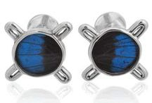 """AYMARA CUFFLINKS / Aymara Designers has now partnered with Cufflinksman.com to create a unique line of Amazonian Butterfly cufflinks made from real butterfly wings. The good news is, not only are these cufflinks """"fly"""" but they were all humanely acquired."""
