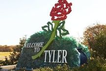 Tyler Texas / Located in the rolling hills of East Texas in Smith County mid-way between Dallas and Shreveport, Tyler has a wide range of appeal.  Tyler's lifestyle is cosmopolitan, yet has the feel, benefits and security of a small town.  It offers benefits such as the East Texas Symphony Orchestra and a variety of plays and musicals, and educational facilities such as TJC and UT-Tyler. It also features the Tyler Spring Azalea Trails and the Texas Rose Festival in the fall.