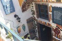 Atlantis Book Mural / Painted by Alma Ayon at a bookshop in Santorini