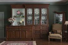 Toulon Butler's Pantry / The warmth of walnut in Matte Potomac contrasts with a Vintage Silver Pine interior in the Toulon Butler's Pantry by Wood-Mode. Leaded glass and angular details enhance the space's Old World appeal.