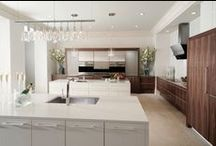 Modern History / The Modern History kitchen by Wood-Mode preserves historic architectural elements while incorporating minimally detailed cabinetry, state-of-the-art appliances, and plenty of functional storage and workspace for the avid chef.