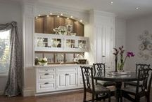 Yardley Butler's Pantry / The classic white Yardley Butler's Pantry by Wood-Mode features beveled glass inserts, mullion detail and a natural walnut interior. Antique mirror backsplash and a dramatic arch draw the eye and capture attention.