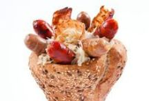 Kolbice - The Hungarian Streetfood / Kolbice is an conventionally tasteful, special cone shaped bread with custom-made, grilled sausages with different toppings and sauces