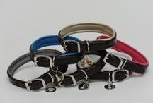 Collars and Leashes / Dedicated to making premium handmade collars and leashes, these luxurious collars are constructed with hand stitched English Bridle Leather, feature a soft garment leather padding in our signature colors, and have extremely durable stainless steel hardware.  Compliment your collar with our 6ft leash, which features a soft garment leather padded handle in our signature colors for the handler's comfort, durable stainless steel swivel hardware that helps lead the dog on your walks.