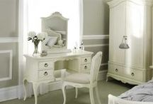 Ivory French Inspired Bedroom Furniture / Taking its inspiration from 18th century French furniture, this collection, crafted from solid Birch and Birch veneers is stylish and sophisticated with mellow tones and soft curves, creating a tranquil, relaxed atmosphere. The distressed paint finish is achieved by applying several layers of paint which are gently aged in places.